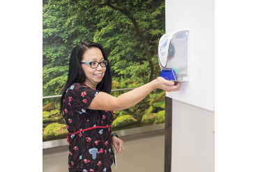 Cleo Yu-Tiamco, Assistant Head Nurse on Short-Stay Medical Unit, cleans her hands.
