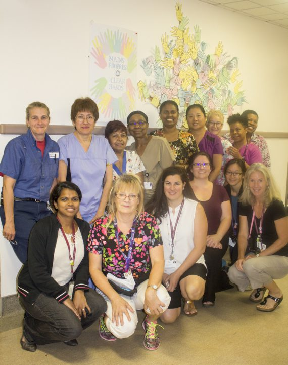 Shown rear row from left, Carol Gervais, Housekeeping Team Leader; Registered Nurse Narcisa Torres; PAB Eileen Sukrham; LPN Jerdean Wright; PAB Nagullah Iruthaya Rajah; Registered Nurse Beverly Wong; LPN Kathleen Prescott; Registered Nurse Danielle Patton; Erna Rodriguez, Admissions Department; and Rehabilitation Secretary Teeshila Rungien. Front row, from right: PAB Nicole Anderson; Rehabilitation Program Manager Catalina Estevez; Ms. O'Grady; Clinical Activities Specialist in Rehabilitation Dorianne Lee Chong; and Physiotherapist Rachel Baker.