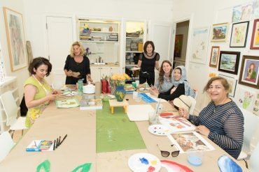 Guests at the Cancer Wellness Centre open house enjoy an art class with Elaine Dubrovsky (standing, left), a volunteer art instructor since the program began.