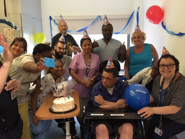 When Ms. Capaz discovered that it was David's birthday in June, she decided to throw him a party. The whole team joined in the planning and festivities, making sure David was dressed for the occasion, decorating his room with streamers and balloons, breaking out the party hats and indulging his sweet tooth with a birthday cake.