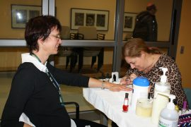 Maimonides Administrative Technician Brenda Barbalat (right) offers a helping hand as a manicurist at JEC Staff Spa Day, giving Dietary Technician Doris Deschênes a pop of colour on a November's day.