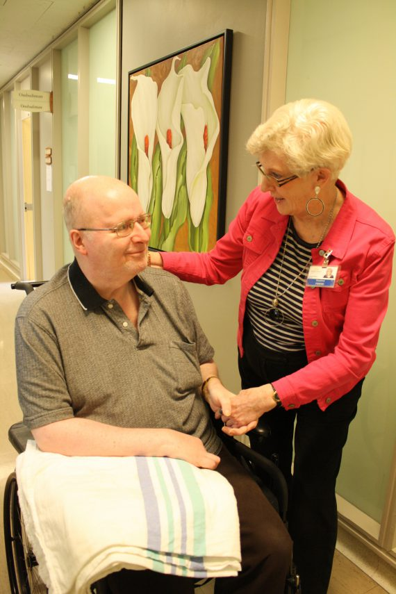 Barbara Cooke, a volunteer at the Donald Berman Maimonides Geriatric Centre, chats with a resident.