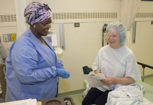 Just prior to discharge, a patient receives eye care information following surgery to remove a cataract.