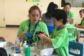 Lethbridge-Layton-Mackay staff member) helping a camper during a science activity at the 2018 developmental coordination disorder camp at the Mackay site