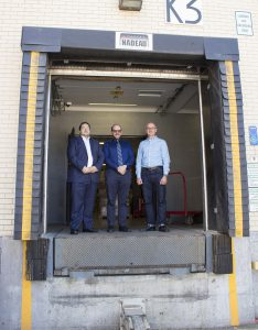 Isaac Maman (left), Elliott Silverman (centre) and François Lemieux gather at the JGH loading dock where they arranged to transport a special therapeutic bed to a patient at Mount Sinai Hospital.