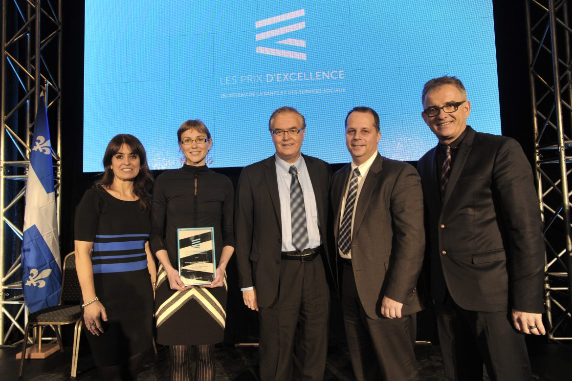 The most recent winner of the Prix d'Excellence within our CIUSSS was Frédérique Binette (pictured second from left), responsible for sustainable development at the former CSSS de la Montagne. She received honourable mention in 2013 for her initiatives supporting the development of sustainable and green neighbourhoods and promotion of eco-responsible food consumption and building management. She was also recognized for organizing activities to raise awareness among staff members. Appearing with Ms. Binette, from left: Véronique Hivon, former Public Health and Youth Protection Minister. Ms. Binette; Marc Sougavinski, Executive Director of the CSSS de la Montagne; Patrick Murphy-Lavallée, former Director of Programs and Services at the Agence, and Réjean Hébert, former Minister of Health and Social Services.