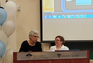 """Hélène Plourde and Isabelle Rhéaume of the Mental Health Directorate, accepting the Public Choice Award for """"Resuming the professional role following mental illness"""""""