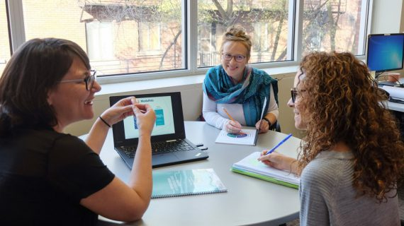 At a meeting at the CLSC Park Extension, contributors discuss a new guide to assist asylum seekers. Left to right, Annie Pontbriand, Head of Coordination at the SHERPA university research centre; Noémie Trosseille, research officer at CERDA; Mélanie M. Gagnon, Head of Coordination at CERDA.
