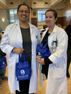 Nurse Clinicians Stacey Payne and Natalie Nava enjoy lunch and one another's company at the JGH holiday party.