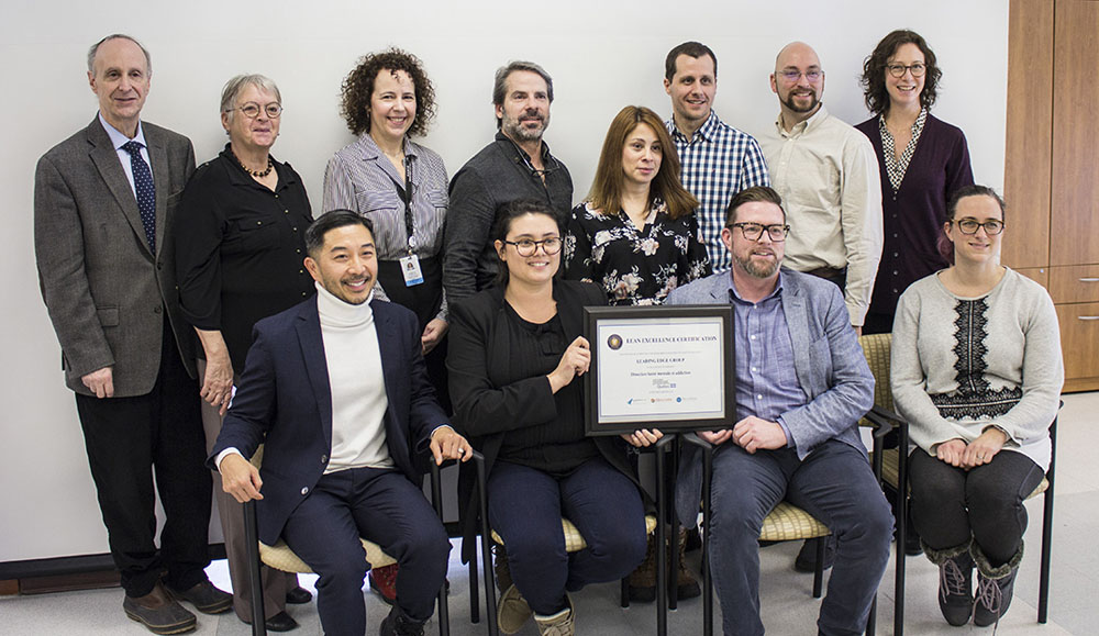 Managers from the Mental Health and Addiction team join their Director, Tung Tran (seated, left), in proudly displaying their Lean certificate, along with Dr. Lawrence Rosenberg (standing, left) and Francine Dupuis (standing, second from left), Associate CEO of CIUSSS West-Central Montreal.