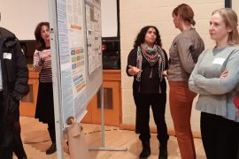Participants view some of the research posters on display at the first Rehabilitation Scientific Day