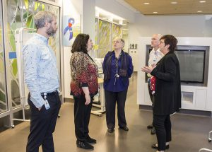 During a tour of the JGH Emergency Department, the need to make optimal use of a family room is discussed by several CIUSSS senior managers—from right: André Poitras, Valerie Schneidman, Francine Dupuis, Serge Cloutier and Lucie Tremblay.