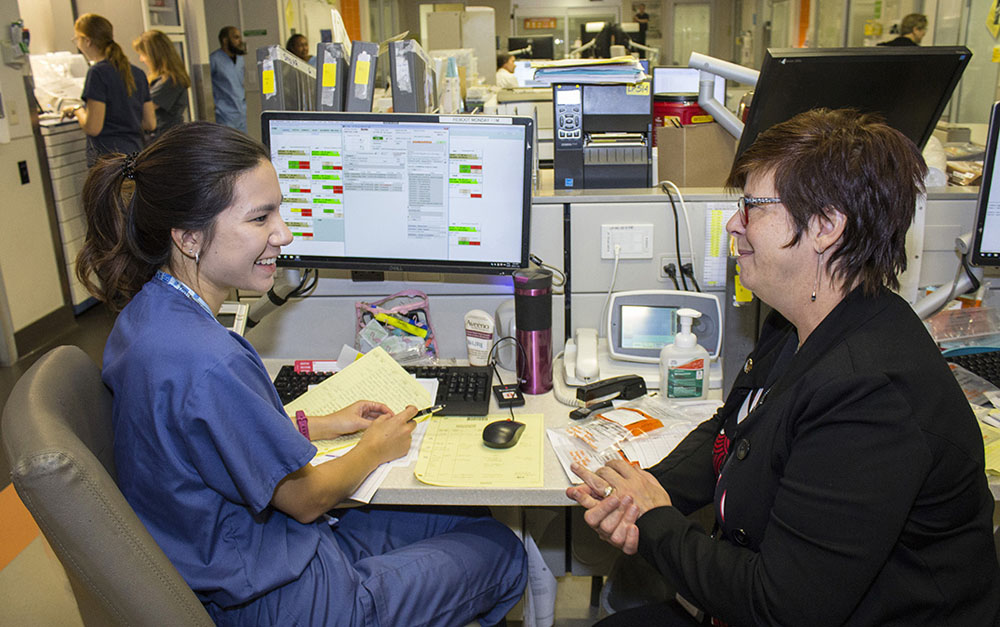 In the JGH Emergency Department, Lucie Tremblay (right), Director of Nursing, chats informally with Nurse Clinician Valerie Lok, who presents her own unique perspective on the department's day-to-day successes and difficulties.