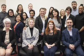 At a meeting of staff from Frontline Integrated Services, including Public Health, employees are joined by (seated, from left) Joanne Côte, Director of Director of Quality, Innovation, Evaluation, Performance and Clinical Ethics; Dominique Dufour, Assistant Director of Frontline Integrated Services; Christine Touchette, Director of Frontline Integrated Services; and Dan Gabay, Associate Executive Director for Quality and Administrative Support.