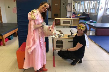 "Speech-Language Pathologist Alexie Gendron(left) and Physiotherapist Sara Wight (right) dress up in costume to lead a 4-year-old girl through a ""virtual"" therapy session on Skype."