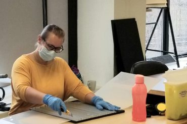 Caroline Gilbert, Orthotics and Prosthetics Technician at the Lethbridge-Layton-Mackay Rehabilitation Centre, at work producing face shields to protect frontline workers
