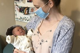 Midwife Kathleen McDonald holds a baby she helped deliver at the Côte-des-Neiges Birthing Centre