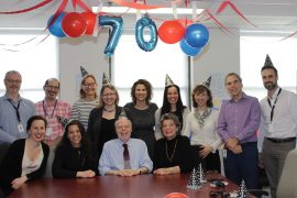 Henry Mietkiewicz (front row, in blue shirt), surrounded by members of the CIUSSS West-Central Montreal Communications team, in March, 2020