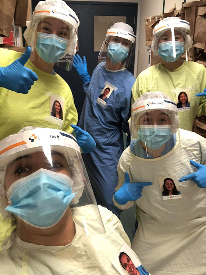 Members of the Catherine Booth rehab team wear photos on their gowns to help connect with patients. Front row, left to right, Stéphanie Sens and Clara Del Degan. Back row, left to right, Julianne Noseworthy, Gabrielle Gaudreault-Malépart, Jenny Do