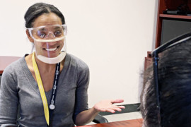 Social worker Ashanta Farrington wears a clear mask at the MAB site of our CIUSSS