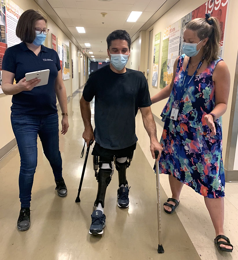 Luca Patuelli tests his computerized C-Brace devices at Constance-Lethbridge, flanked by Orthotics and Prosthetics Technician Geneviève Levert (left) and Physiotherapist Jessy-Ann Lapointe.
